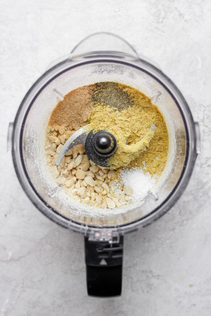 vegan parmesan cheese in a food processor about to be blended