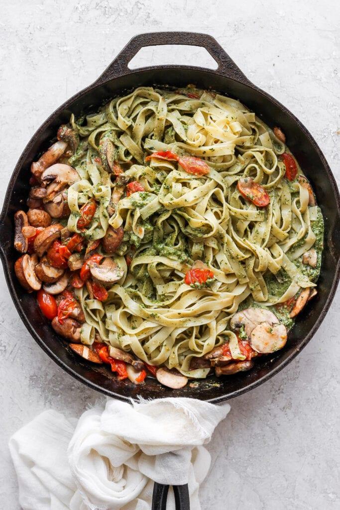 Vegan pesto pasta in a cast iron skillet.