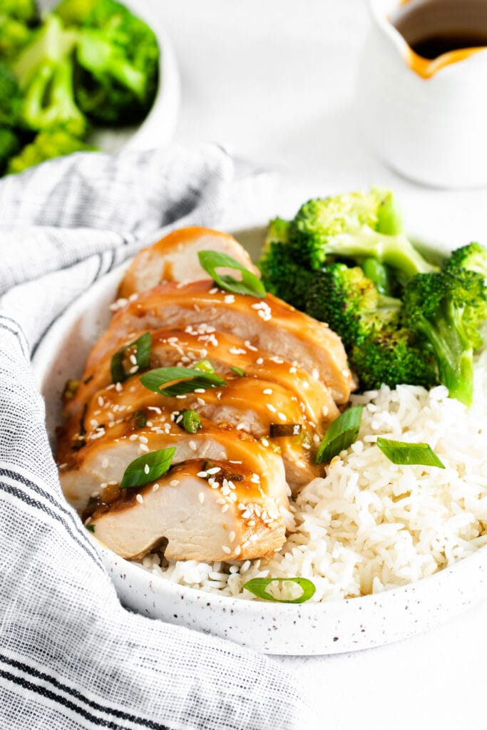 sliced teriyaki chicken with white rice and broccoli in bowl