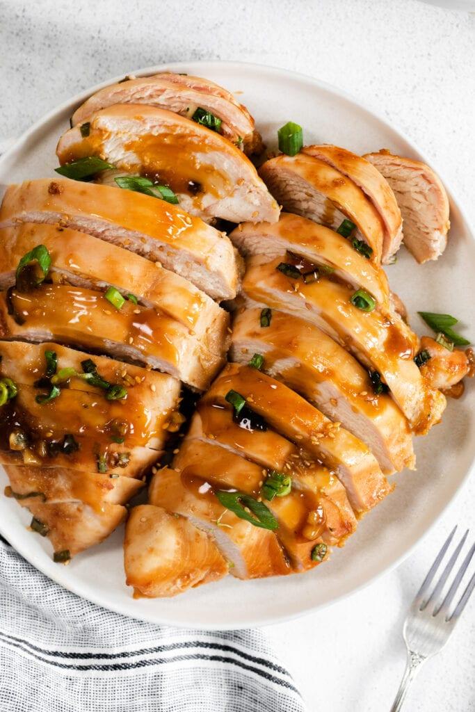 sliced teriyaki chicken on plate