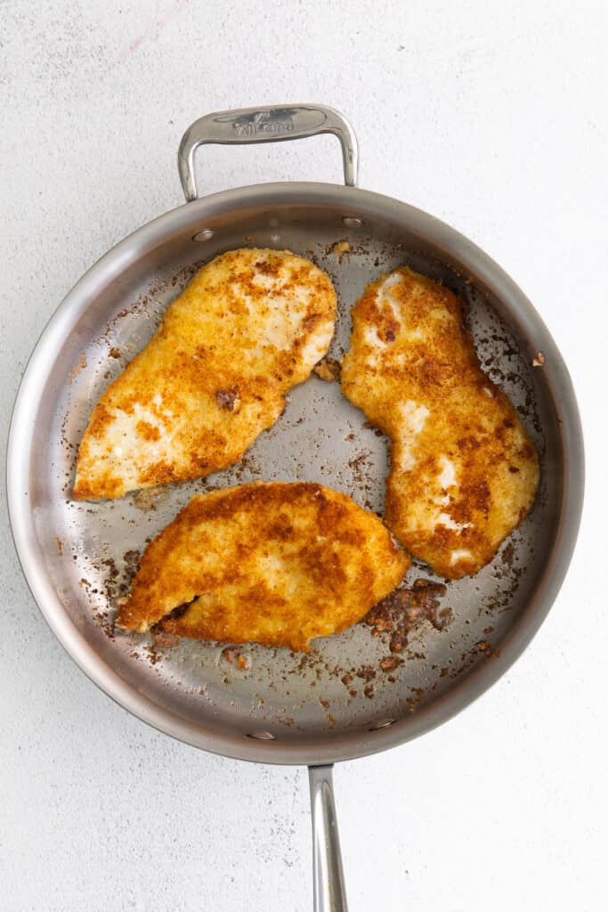 parmesan crusted chicken in frying pan