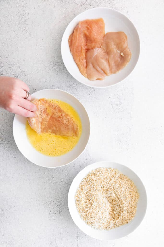 dipping chicken breast in egg wash