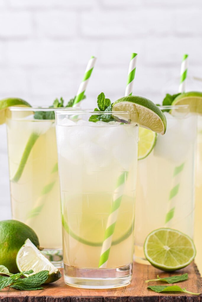 limeade in a glass garnished with a fresh lime slice and fresh mint