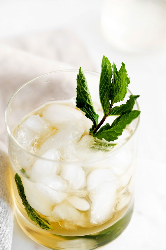 mint julep in a glass garnished with fresh mint