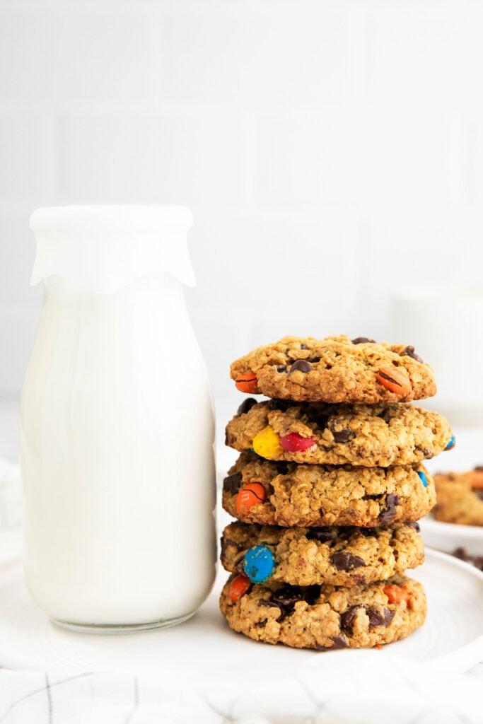 stack of cookies next to milk