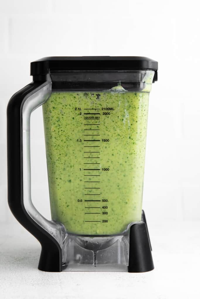 Tropical Spinach Smoothie blended up in a blender.
