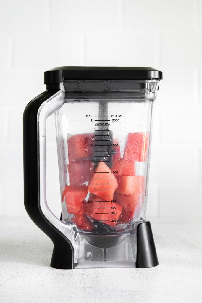 Watermelon cubes in a high speed blender.