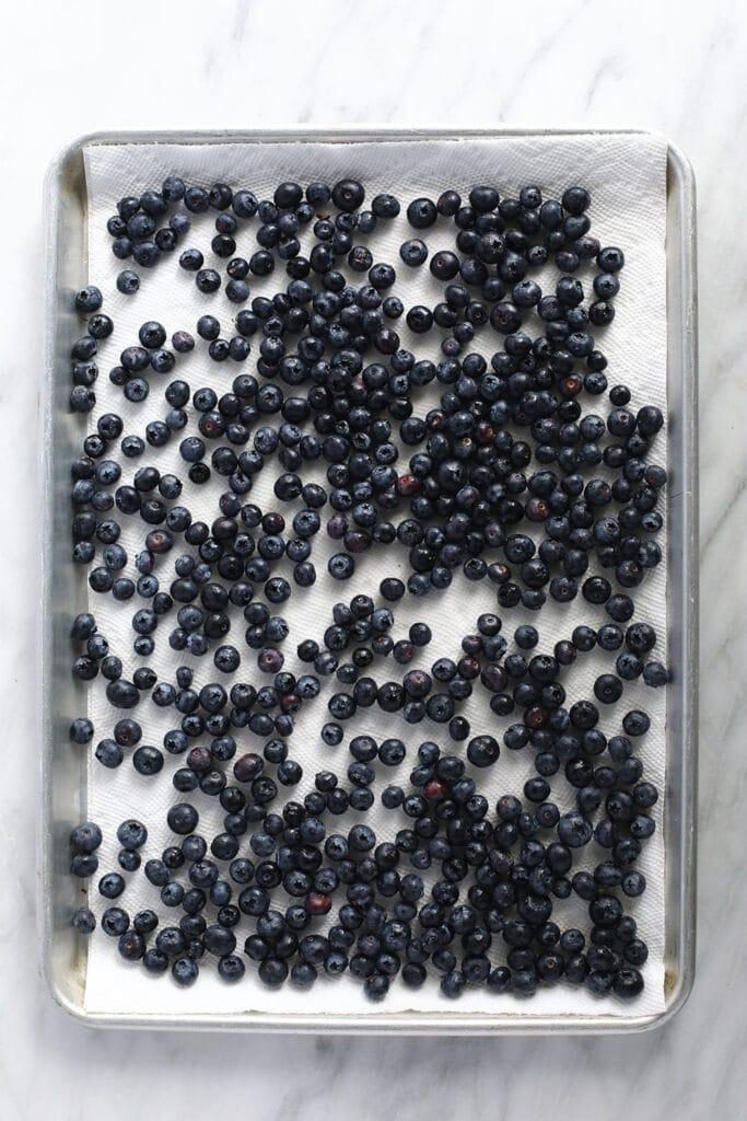 blueberries on baking sheet