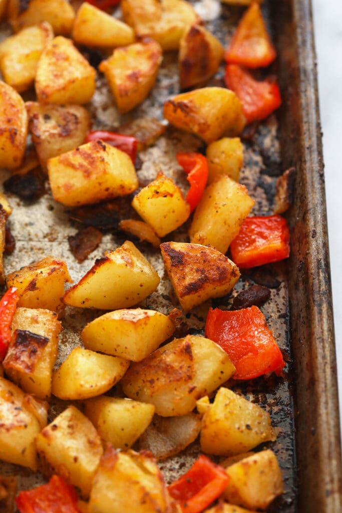 breakfast potatoes on a baking sheet looking crispy and delicious