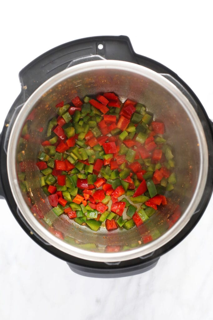 sauteed red and green peppers in the instant pot for instant pot burrito bowls