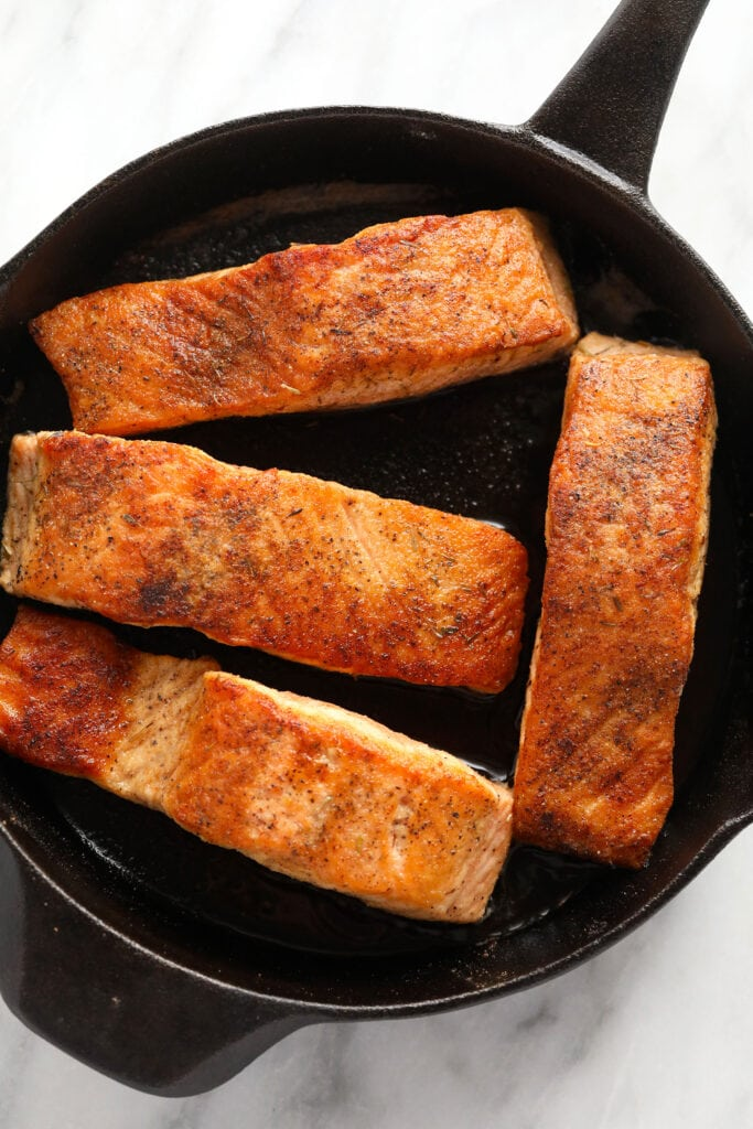 Salmon filets in a cast iron.