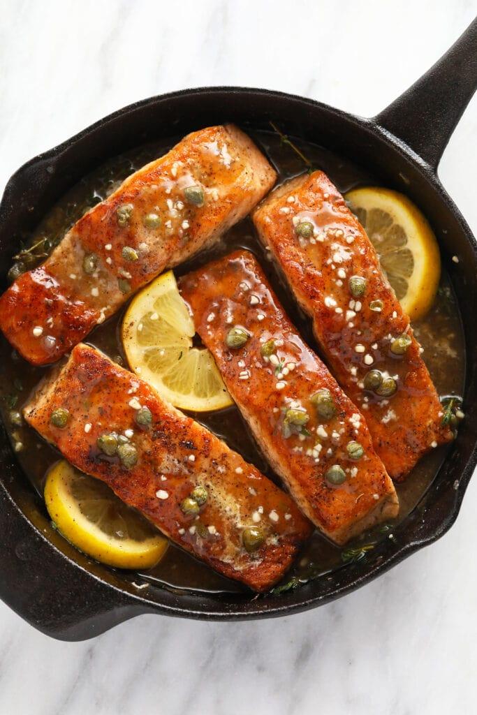 Salmon piccata in a cast iron.