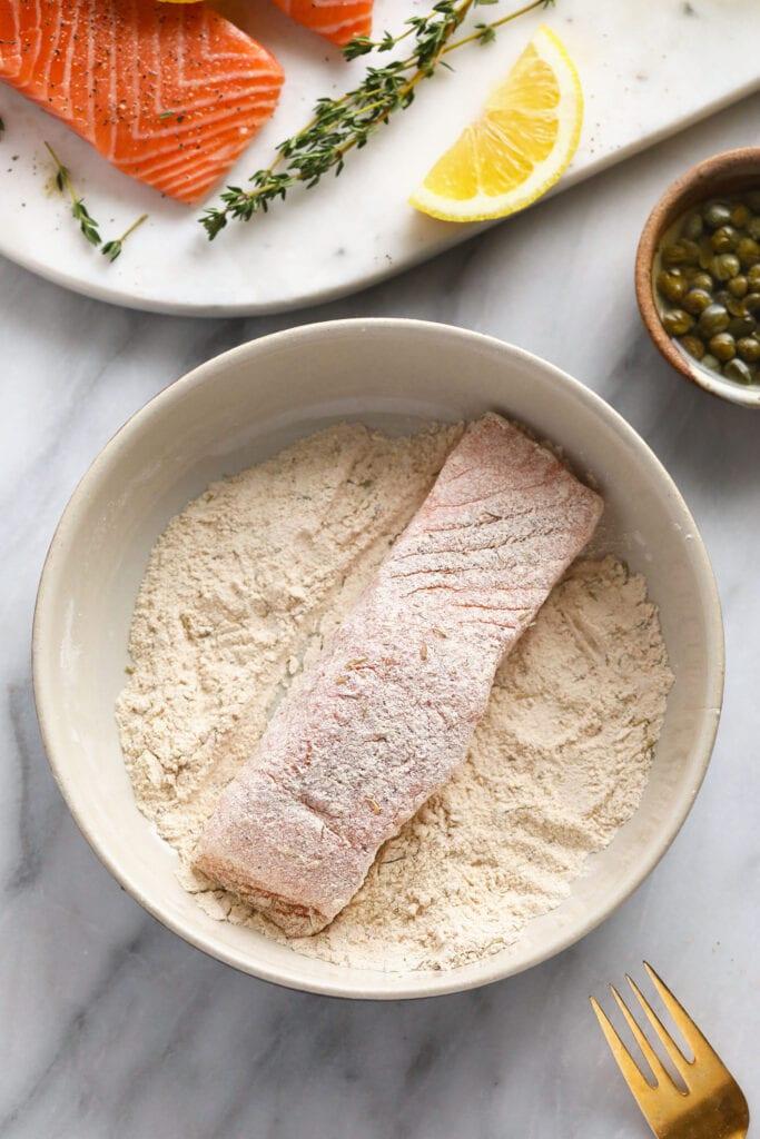Dredging salmon through flour.