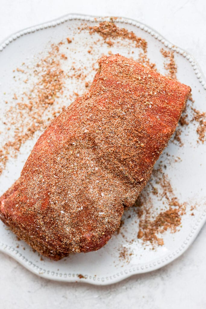 A pork roast dry rubbed in spices.