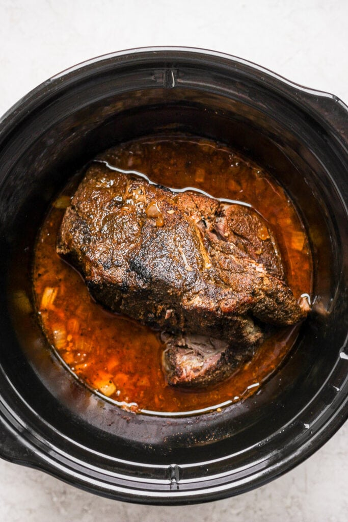 Pork shoulder cooked in a slow cooker.