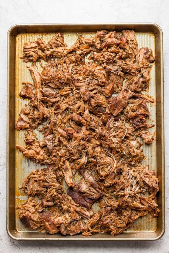 Carnitas on a baking sheet.