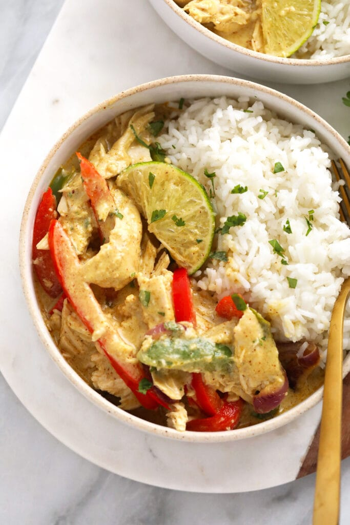 A bowl of coconut curry chicken and rice.