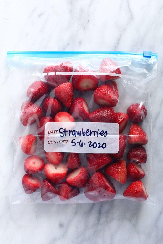 Frozen strawberries in a bag.