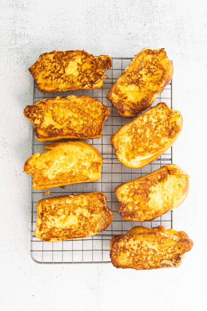 cooked french toast on a cooling rack and ready to be served
