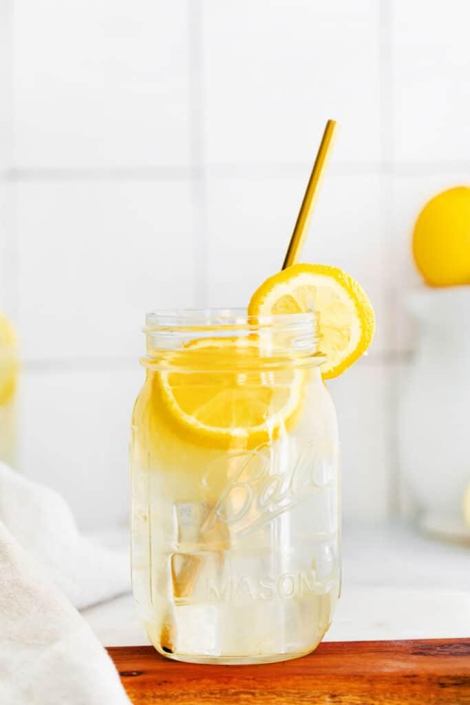 A mason jar full of lemonade.