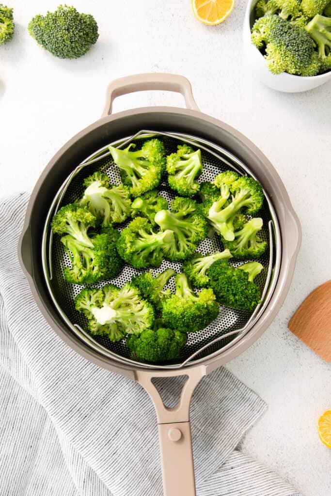 steamed broccoli in steamer basket