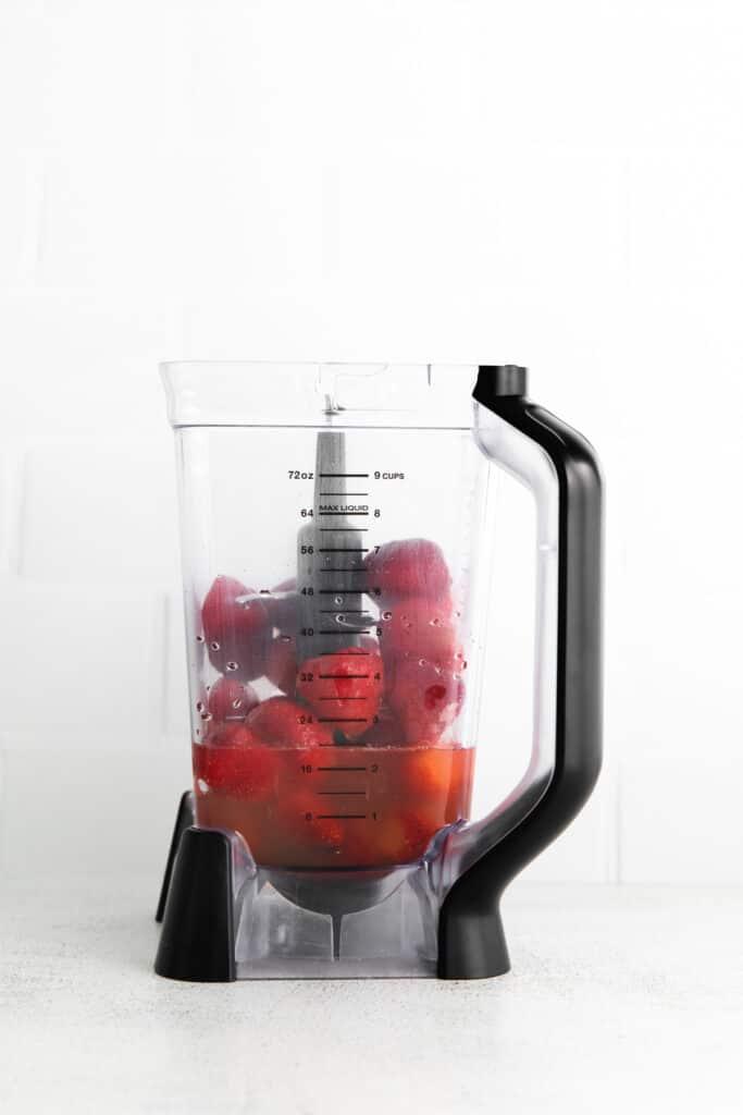 strawberries and rum in blender