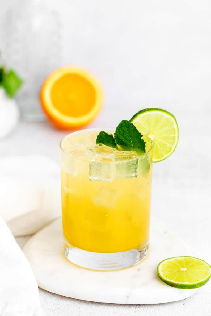 margarita with mint and a lime wedge