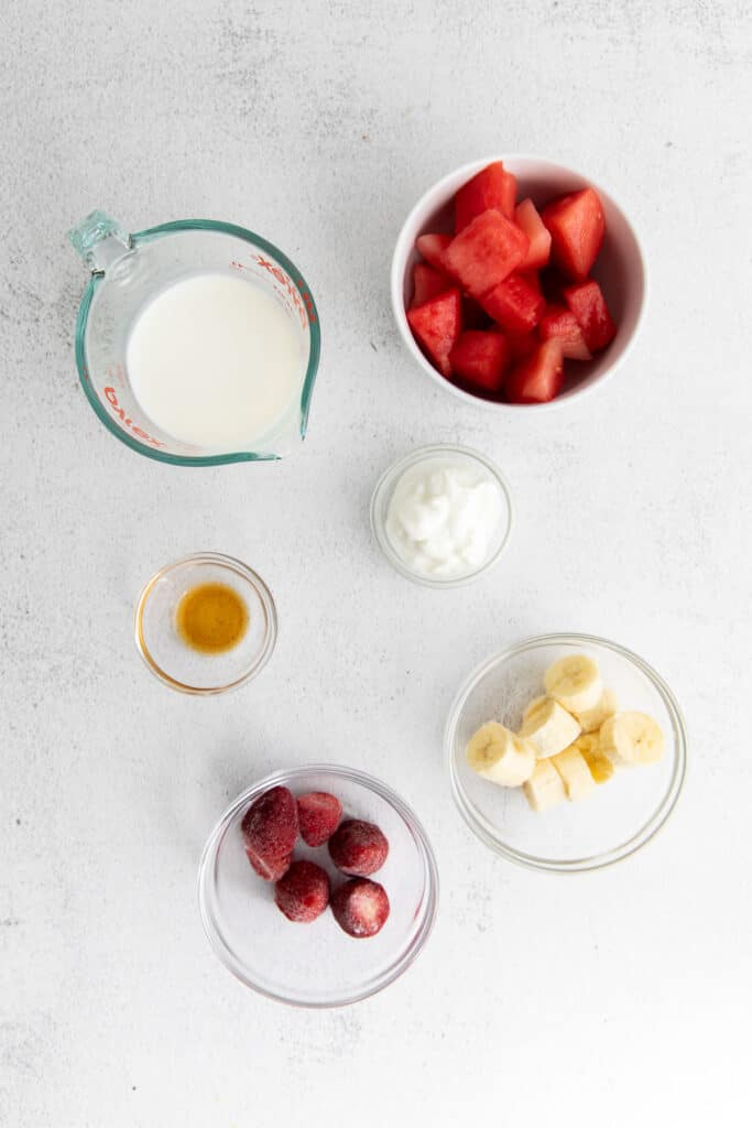 All the ingredients for the watermelon smoothie in small bowls.
