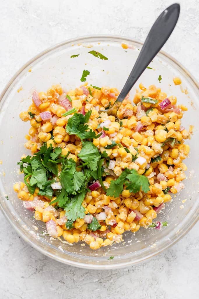 Mexican street corn salad in glass bowl