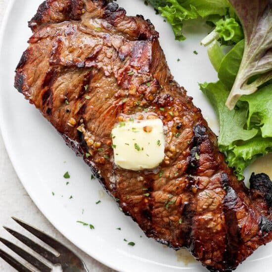 grilled steak on plate with butter