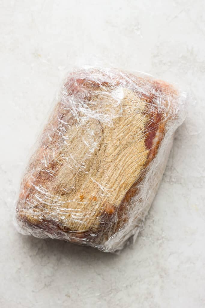 pork wrapped in plastic wrap