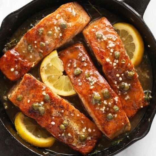 Salmon piccata in a cast iron skillet