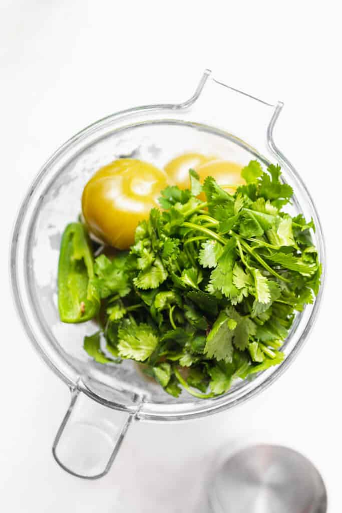 All the ingredients for this salsa verde recipe in a blender.