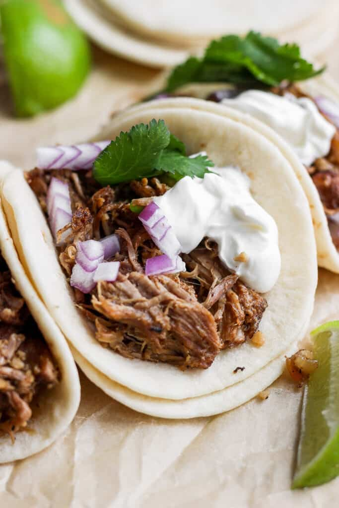 Carnitas tacos on a plate.