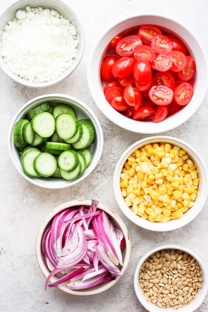 steak salad ingredients in bowls