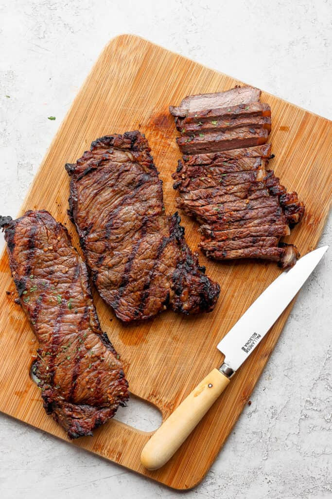 sliced cooked steak on cutting board