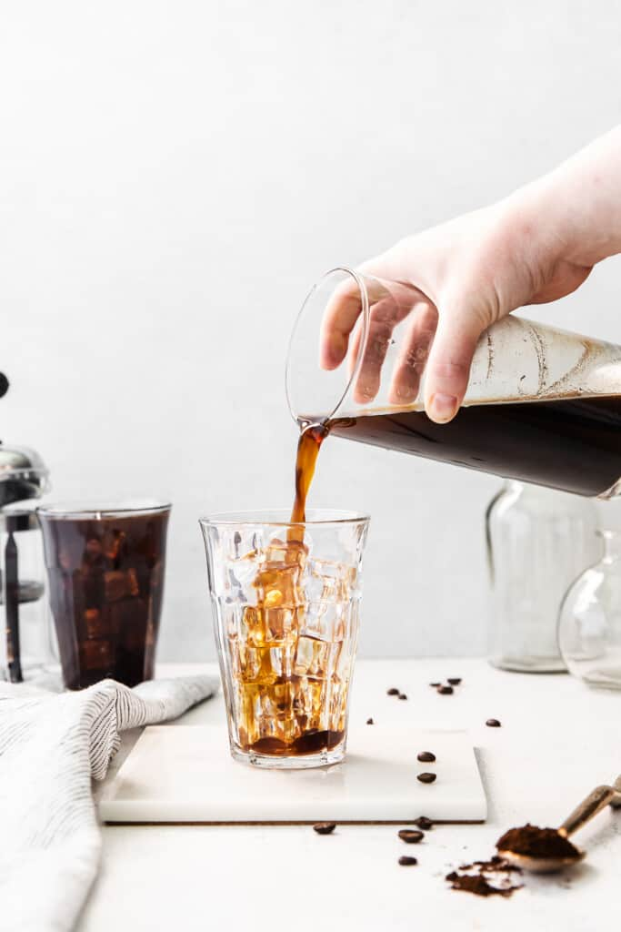 Pouring cold brew coffee into a glass