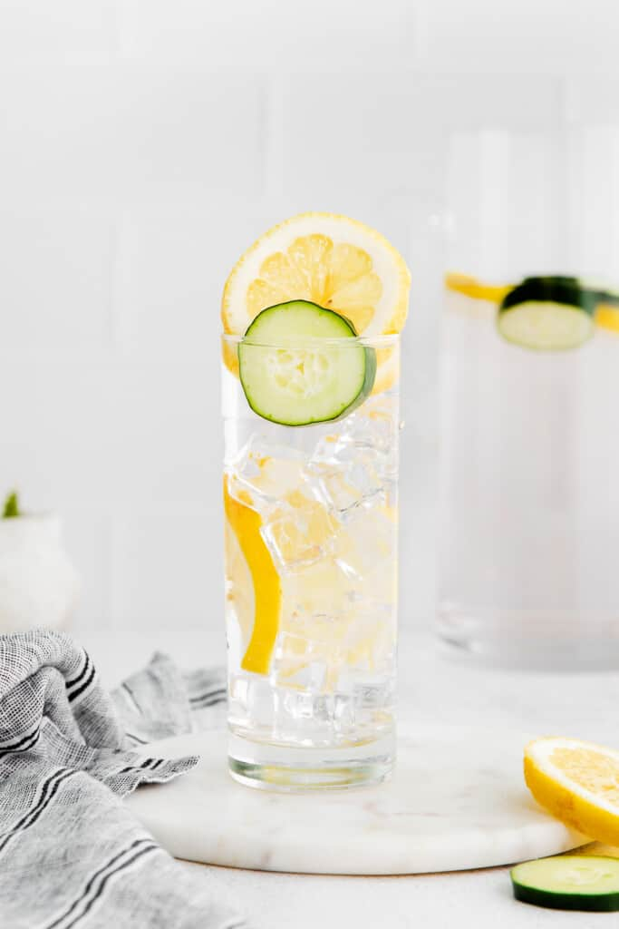 Cucumber and lemon infused water in a glass.