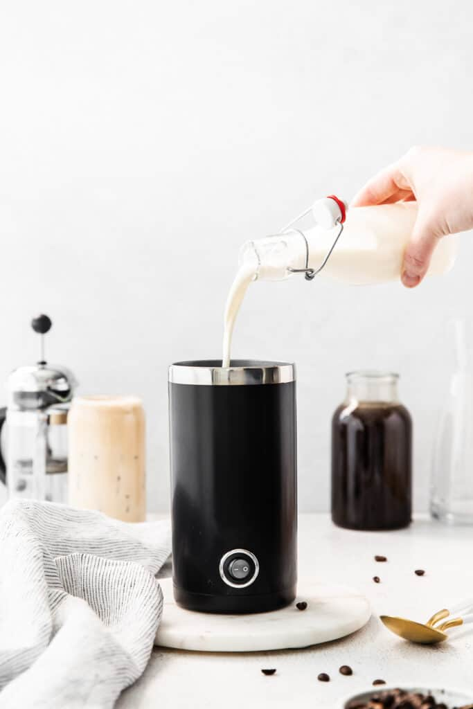pouring vanilla sweet cream into frother