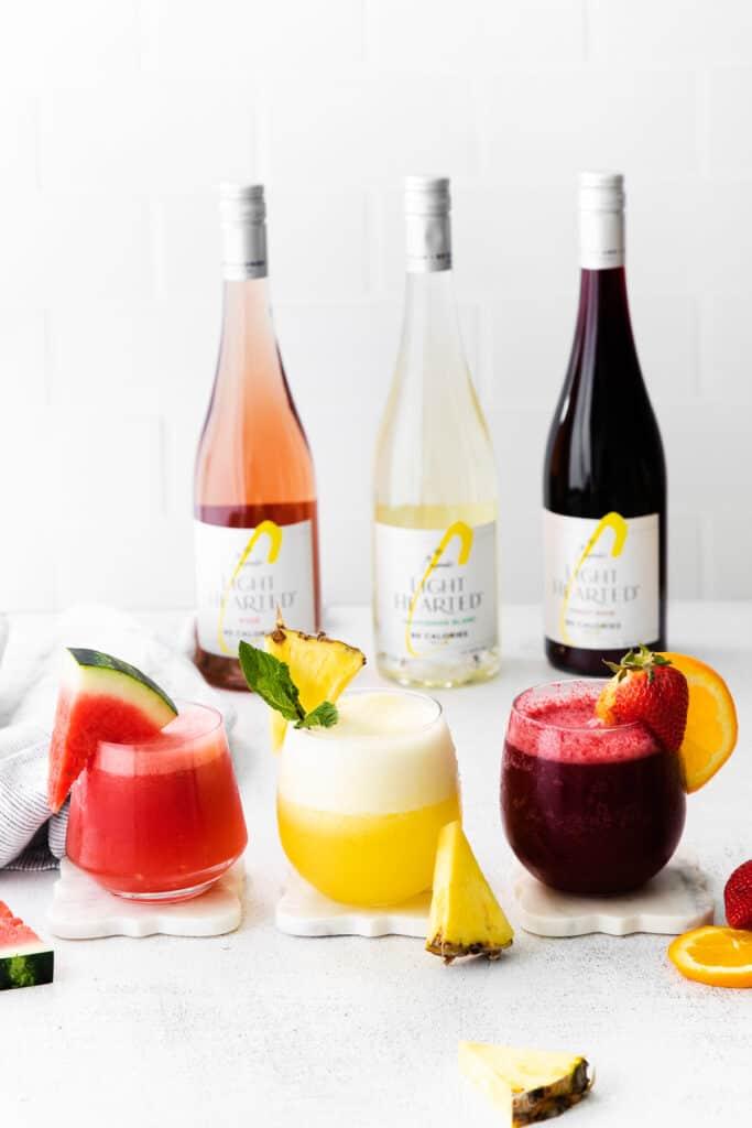 3 frozen wine slushies with 3 bottles of wine