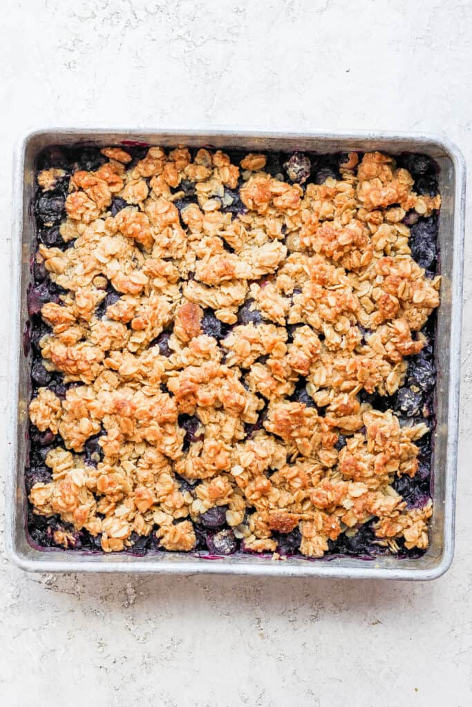 Blueberry crisp with a golden oatmeal topping.