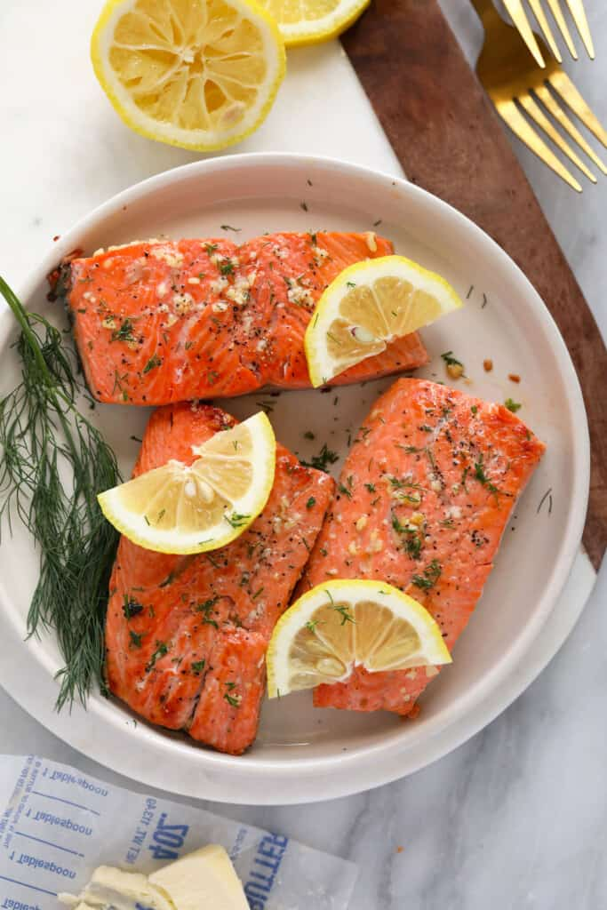 cooked salmon fillets on plate