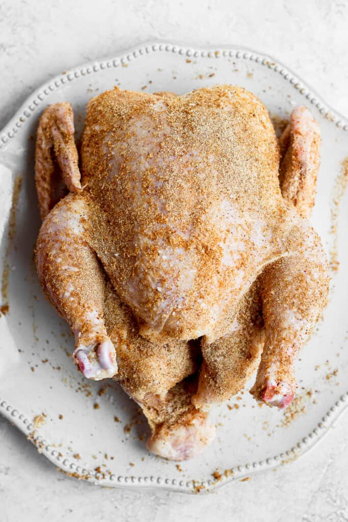 A whole chicken rubbed with smoked chicken dry rub.