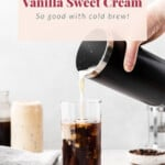 Pouring sweet cream into cold brew coffee.