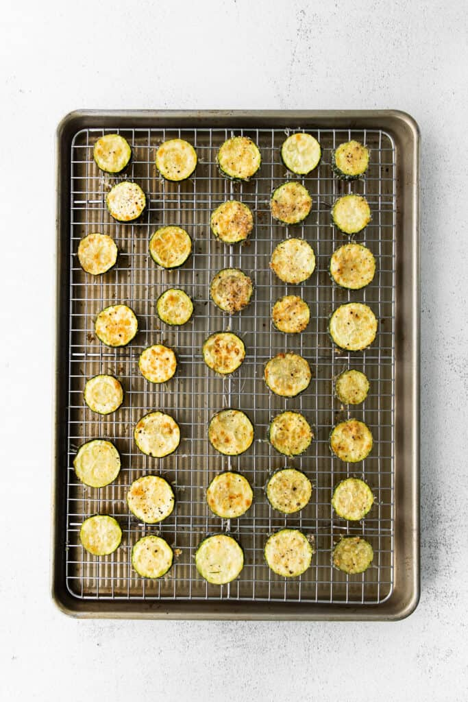 Baked Zucchini on a baking sheet.