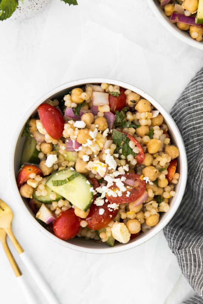 individual serving of mediterranean couscous salad in a bowl