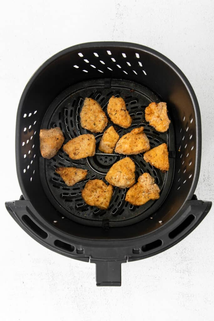 Air fryer chicken nuggets after they've been cooked.
