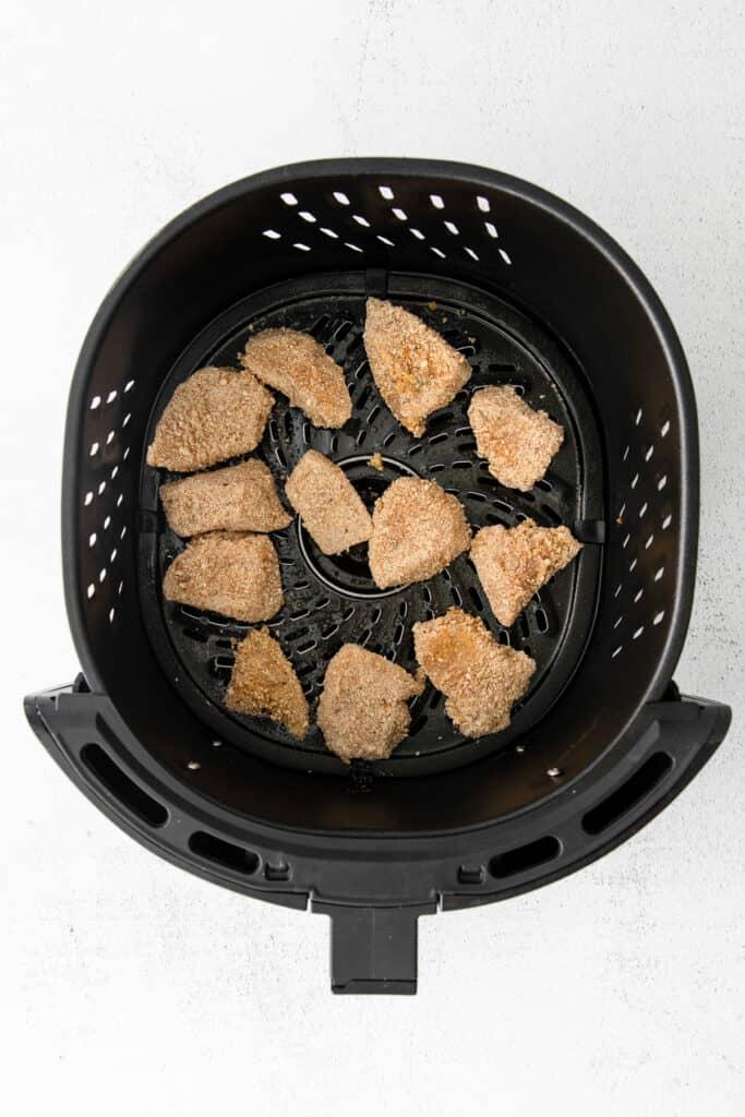 Chicken nuggets in the air fryer basket.