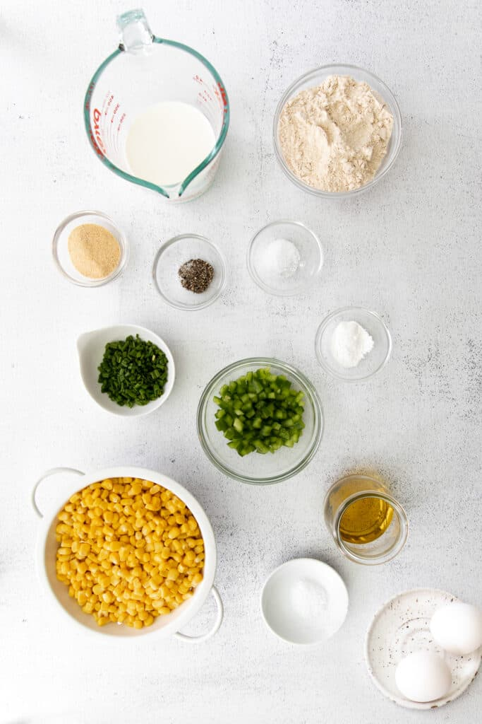 Corn, chives, pickled jalapenos, oil, and spices for corn fritteres.
