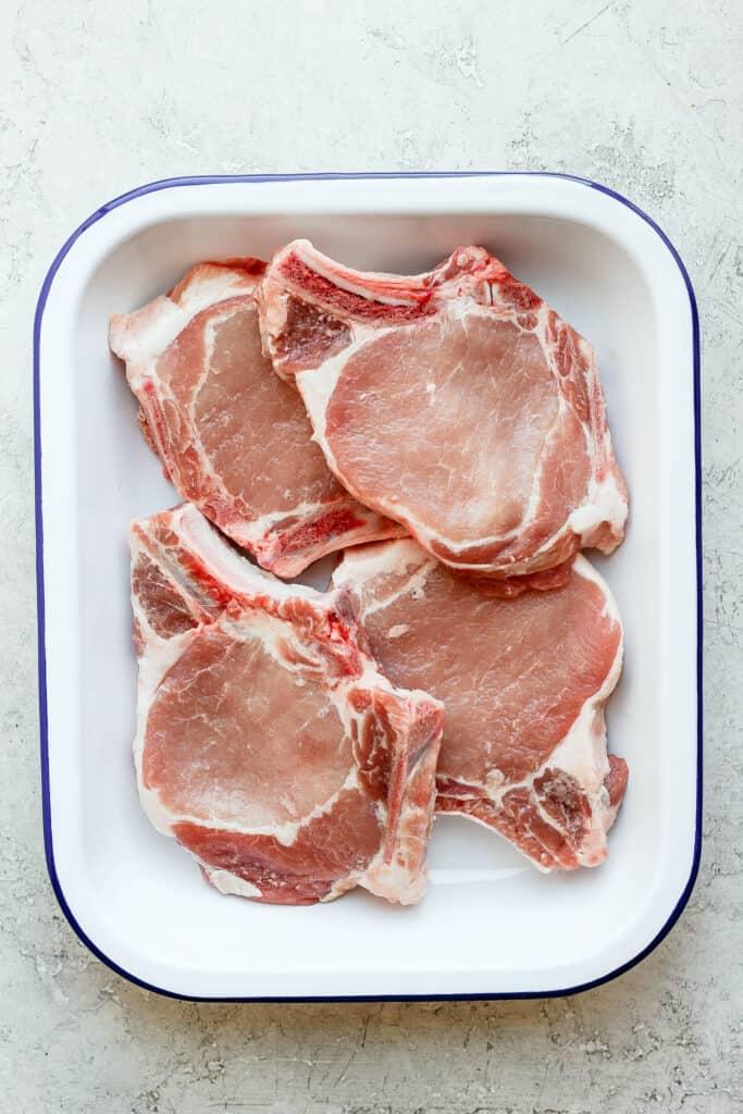 raw pork chops in dish